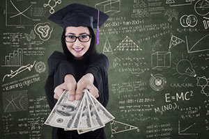 Graduate holding money in front of chalk board